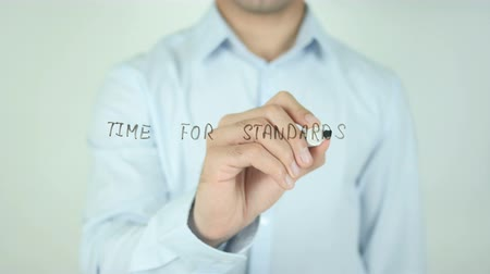 standardization : Time for Standards, Writing On Transparent Screen Stock Footage