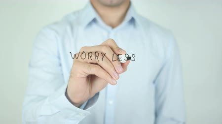 mais : Worry Less, Writing On Transparent Screen Stock Footage