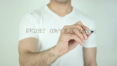 excuses : Excuses Do not Burn Calories, Writing On Transparent Screen Stock Footage