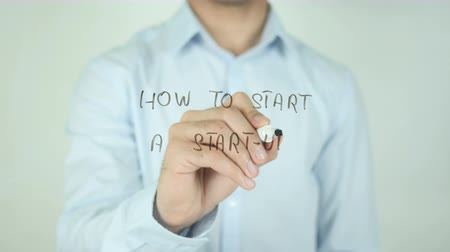 kezdődik : How to Start a Startup?, Writing On Transparent Screen Stock mozgókép