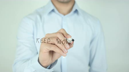 idiom : Keep Working, Writing On Transparent Screen Stock Footage