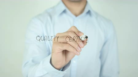 medir : Quality Certified, Writing On Transparent Screen