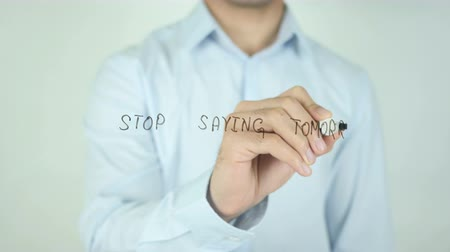 отходы : Stop Saying Tomorrow, Writing On Transparent Screen Стоковые видеозаписи