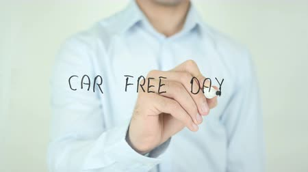 щит : Car Free Day &, Man Writing on Screen