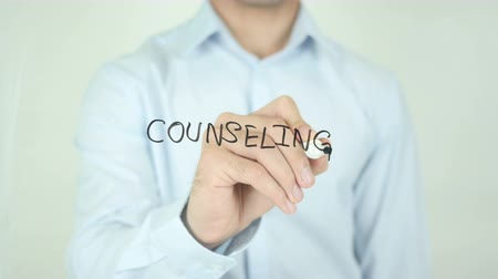 counselling : Counseling, Man Writing on Screen Stock Footage