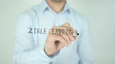 przywództwo : Achieve Goal In German Language, Ziele Erreichen, Writing On Transparent Screen
