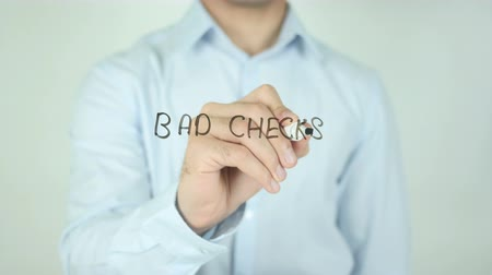 cheated : Bad Checks, Writing On Transparent Screen Stock Footage