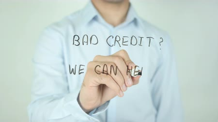 cheated : Bad Credit? We Can Help!, Writing On Transparent Screen Stock Footage