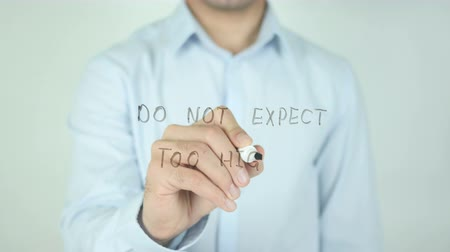 idiom : Do not Expect too highh, Writing On Transparent Screen Stock Footage