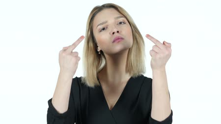 гнев : Angry Young Woman shows Middle Finger, White Background