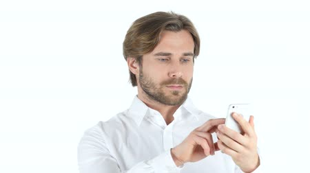 szőke : Using Smartphone, Texting Young Man with Curly Hairs Stock mozgókép
