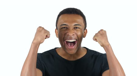 izgatott : Excited Black Man Celebrating His Success Stock mozgókép