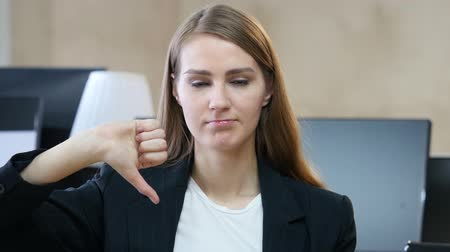 businesswomen : Thumbs Down by Woman in Office Stock Footage