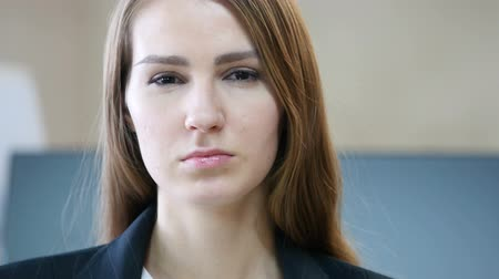 donjon : Close Up of Serious Woman Face in Office