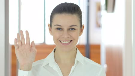 welcome sign : Hello by Woman, Indoor Waving Hand