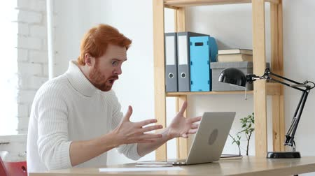 aggression : Angry Man with Red Hairs Reacting to Problems and Misunderstanding Stock Footage