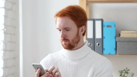 navegador : Browsing Online on Smart phone, Man with Red Hairs Stock Footage