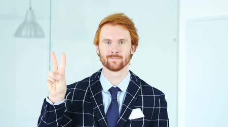 siker : Victory Sign by Beard Redhead Businessman in Office