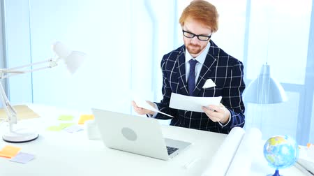 leitor : Paperwork by Man Reading Office Douments at Work, Red Hairs
