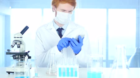 healthy office : Scientist Using Smartphone in Laboratory for Browsing Stock Footage