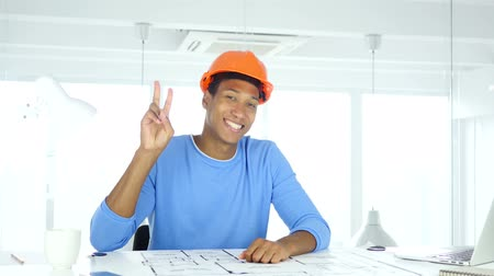 siker : Victory Sign by Afro-American Architectural Engineer at Work Stock mozgókép