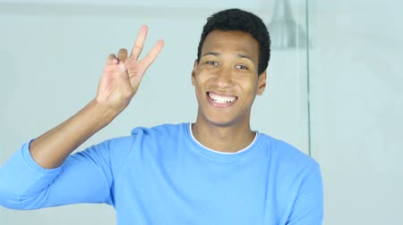 siker : Victory Sign by Successful Young Afro-American Man Stock mozgókép
