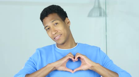 roliço : Heart Sign of Love by Afro-American Man Stock Footage
