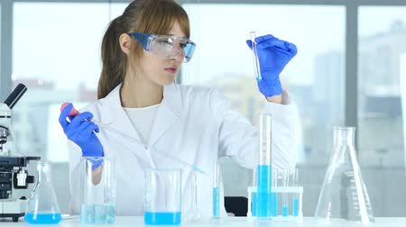 prova : Female Young Scientist Doing Reaction in Laboratory