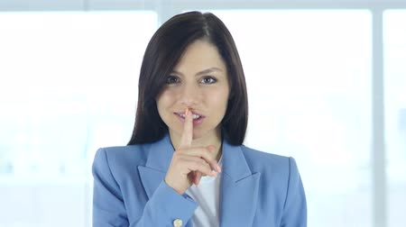 calçadão : Gesture of Silence by Young Woman, Finger on Lips Stock Footage