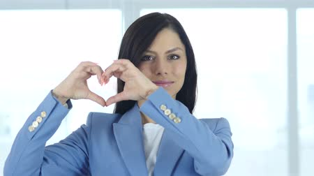 roliço : Heart Sign of Love by Young Woman Stock Footage