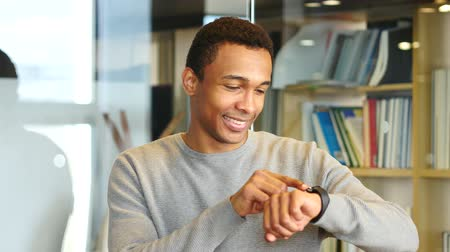 navegador : Young Afro-American Man Browsing Online on Smartwatch