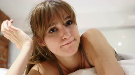 denying : Close Up of Unsatisfied Woman Denying Offer, Lying in Bed Stock Footage