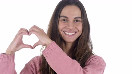 roliço : Heart Sign by Young Latin Woman in Love, White Background