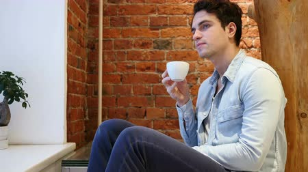 кружка : Pensive Young Man Drinking Coffee from Cup, Loft interior