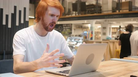 irritáció : Displeased, Angry Man Reacting to Problems of Work in Cafe Stock mozgókép