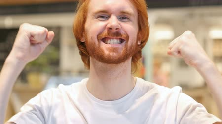 vöröshajú : Portrait of Happy Redhead Beard Man Celebrating Success Stock mozgókép