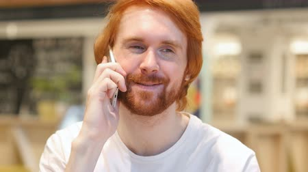 eatery : Redhead Beard Man Talking on Phone, Attending Phone Call Stock Footage