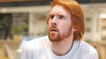 bakıyorum : Frightened Redhead Beard Man Feeling Scary and Confused