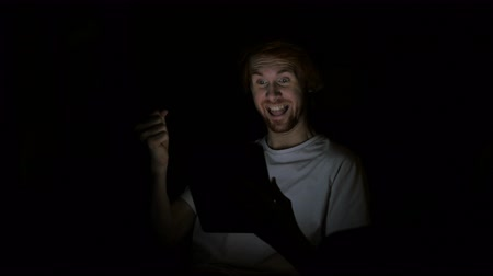 慶典 : Redhead Man Reacting to Success while Using Tablet at Night