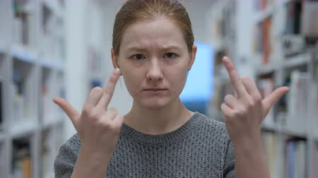 eatery : Frustrated Young Woman Showing Middle Finger in Anger