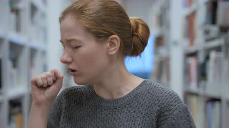garganta : Portrait of Young Woman Coughing, Throat infection Stock Footage