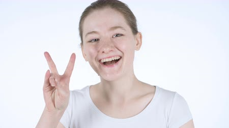 siker : Victory Sign by Young Redhead Woman
