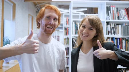 conferência : Thumbs Up by Teamamtes, Man and Woman Office Portrait