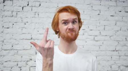 irritáció : Slow Motion of Middle Finger by Redhead Designer Man in Office