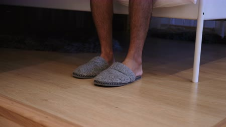 klapki : Close Up of Man Wearing slippers and Leaving Bedroom