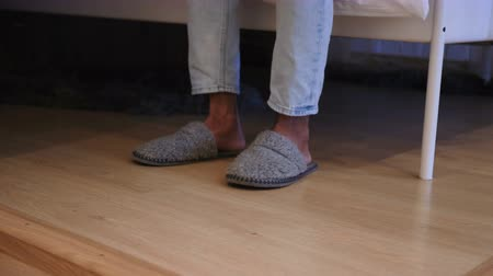 klapki : Man Wearing slippers and Leaving Room, Close Up