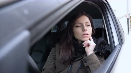 sale : Thinking Pensive Woman Sitting in Car