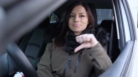 projektant : Thumbs Down by Young Woman Sitting in Car