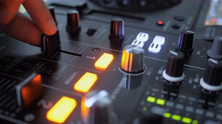 enstrüman : Close up of Hand Increasing Sound of DJ Instrument, Moving Fader Stok Video