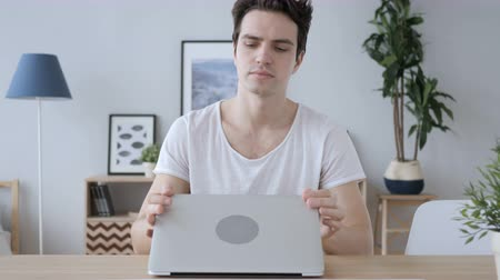 desperate student : Creative Man Leaving Office and Taking Laptop